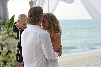 Virtual Celebrant and lovely couple, next to sea, crying bride.